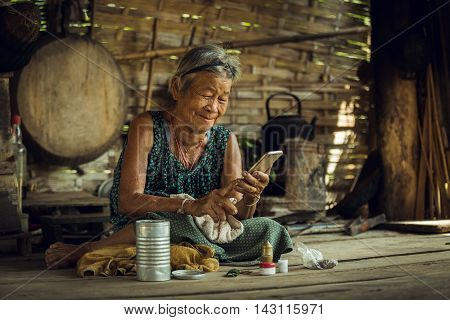 Old woman playing phone concept jumping happily chat messages to the family.