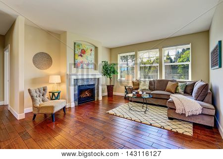 Cozy Living Room With Fireplace, Beige Walls And Hardwood Floor