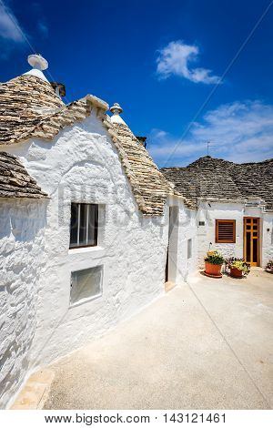 Alberobello Italy Puglia. Unique Trulli houses with conical roofs. Trullo is an a traditional Apulian dry stone hut with a conical roof.