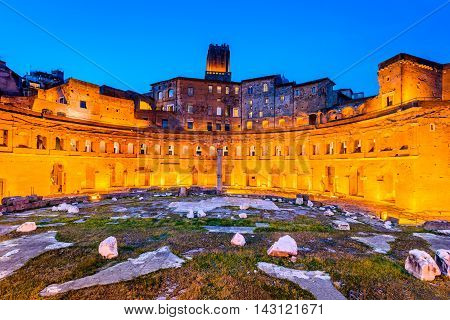 Rome Italy. Twilight view of ancient Trajan's Market ruins in Via dei Fori Imperiali Roma.