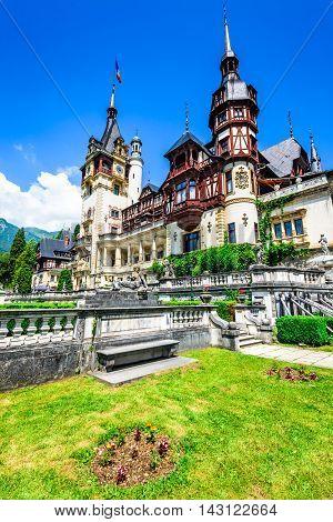 Peles Castle Romania. Beautiful famous royal residence with ornamental garden in Sinaia Carpathian Mountains Europe.