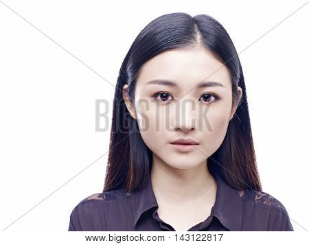 passport photo of a young and beautiful asian girl isolated on white background.