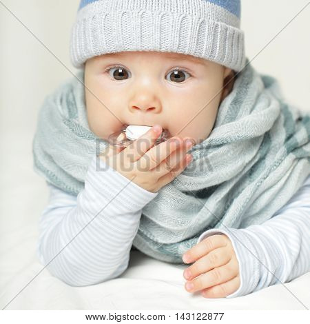 Little Baby with soother on white background