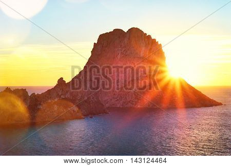Sunset at Es Vedra, the famous and majestic rock formation on Ibiza Island.