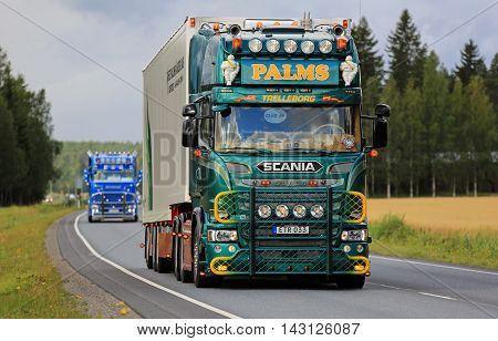 URJALA, FINLAND - AUGUST 11, 2016: Green Scania V8 of K.E.Palms Akeri moves along highway in truck convoy on the way to the annual trucking event Power Truck Show 2016 in Alaharma Finland.