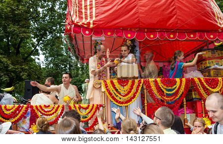 Moscow Russia - August 14 2016: Independence Day of India Celebration. Ratha Yatra. Chariot with deities: Jagannath Balarama and Subhadra. Prasad.