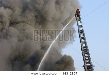 Huge fire being put out