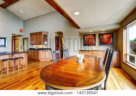 Open Plan Dining Area With Table Set Connected To Kitchen