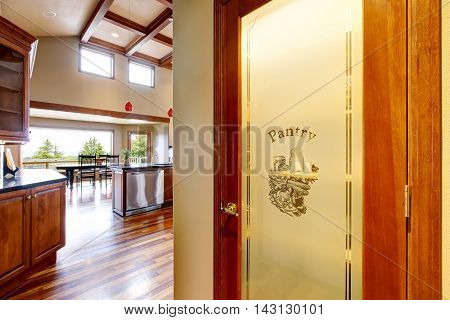 Kitchen View And Pantry Door At The Foreground