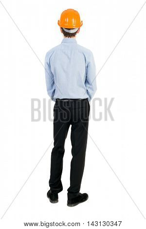 Backview of an engineer in construction helmet stands. Standing young guy. Rear view people collection.  backside view of person.  Isolated over white background. The curly-haired businessman in light