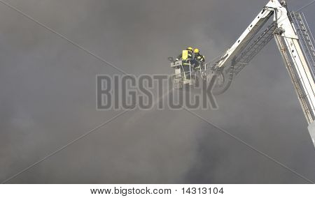 A firefighter putting out a large fire