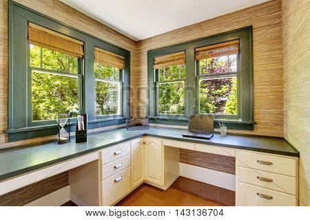 Home Office In Green Tones And Hardwood Foor