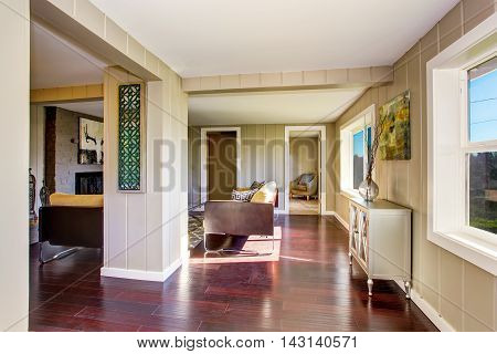 Hallway Interior With Wooden Pannel Trim And Hardwood Floor