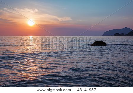 Sunset over calm sea - pastel colors