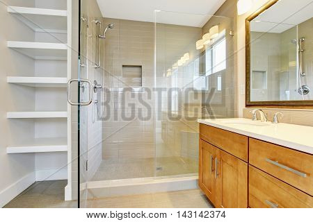 Bathroon Interior With Vanity Cabinet, Two Sinks And Opened Glass Shower Door