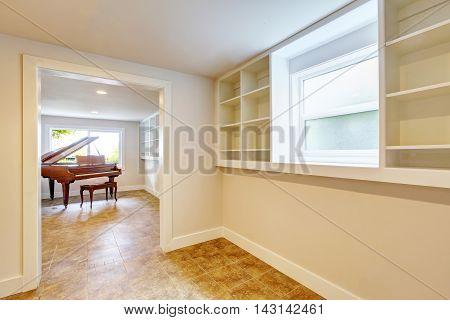 Open Floor Plan Interior With Light Tones Walls And Tile Floor.