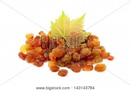 A bunch of dry raisins with a green leaf vine.Isolated on a white background.