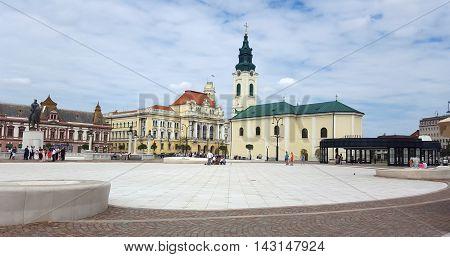 ORADEA ROMANIA - 08.14.2016: Union square and Roman Catholic Church landmark architecture