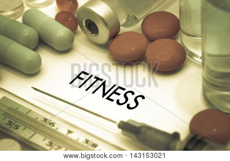 Fitness. Treatment and prevention of disease. Syringe and vaccine. Medical concept. Selective focus