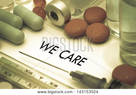 We care. Treatment and prevention of disease. Syringe and vaccine. Medical concept. Selective focus