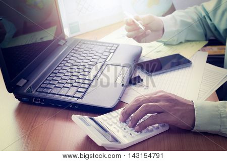 Hands Of A Man Working On Office Desk In Shinning Light