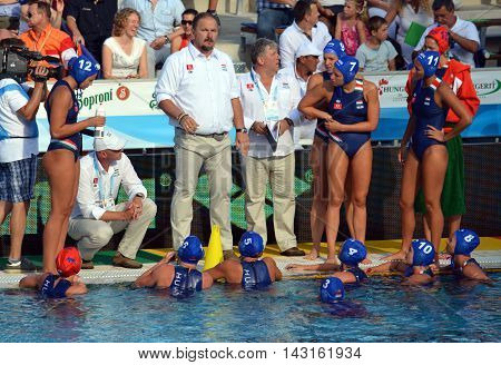 Budapest, Hungary - Jul 16, 2014. Hungary's Andras MERESZ head coach talking about the tactics. The Waterpolo European Championship was held in Alfred Hajos Swimming Centre in 2014.