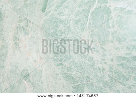Closeup surface abstract marble pattern at the green marble stone floor texture background