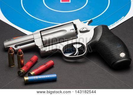 Las Vegas NV USA - January 25 2016: Closeup of Taurus Judge 4510 revolver with .410 guage and .45 long Colt ammunition.