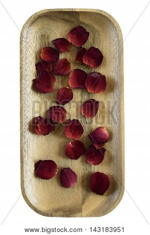 red rose petals on a wooden tray