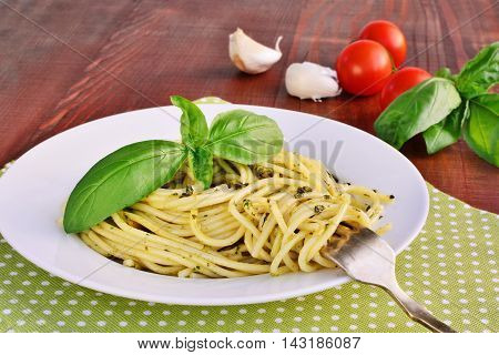Italian pasta spaghetti with pesto sauce and basil leaf. Spaghetti al pesto.