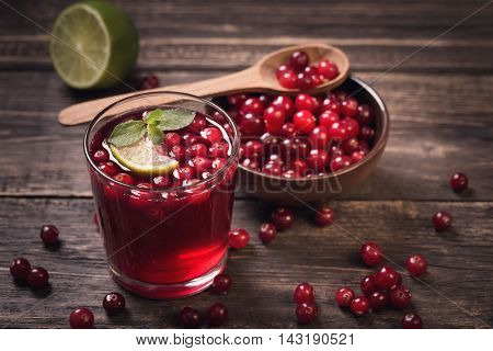 Cranberry juice with mint on old wooden table