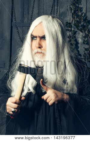 Man In Wig With Axe