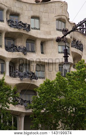 BARCELONA SPAIN - JUNE 15 2016: Casa Mila better known as La Pedrera. This famous building was designed by Antoni Gaudi included in the list of UNESCO