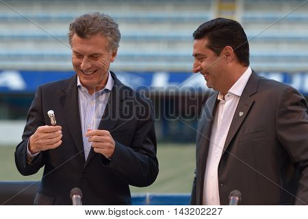 BUENOS AIRES ARGENTINA - DEC 2 2015: Newly elected president of Argentina Mauricio Macri (L) at ceremony to honor him for his work as President of Boca Juniors between 1995 and 2007 with president of Boca Juniors' Daniel Angilici (R)