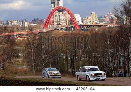 Moscow Russia - Apr 18 2015: VW Polo (L) driver Zakharov Anton and Sevastianov Andrey and Lada-2105 (R) driver Baikov Klim and Lopatin Stanislav during the Rally Masters Show 2015.