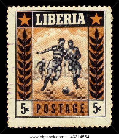 LIBERIA - CIRCA 1955: a stamp printed in the Liberia shows soccer players in action, series sport, circa 1955