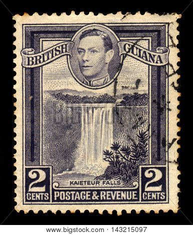 BRITISH GUIANA - CIRCA 1938: a stamp printed in British Guiana shows Kaieteur Falls, waterfall on the Potaro River, Guyana and King George VI, circa 1938