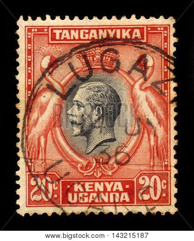 KENYA, UGANDA AND TANGANYIKA - CIRCA 1935: A stamp printed in British Territory of Tanganyika shows medallion portrait of King George V, surrounded of storks, circa 1935