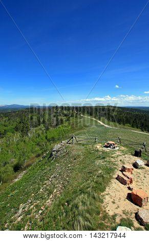 Cement Ridge road alongside split rail fence view of the Black Hills in South Dakota USA