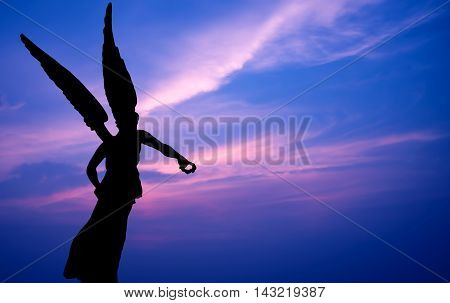 Silhouette of Beautiful angel over magnificent sky