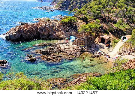 GIRONA/SPAIN - 14 AUGUST 2016: People enjoying summer in Cala Xania near Palamos. In this bay found inspiration to write his book