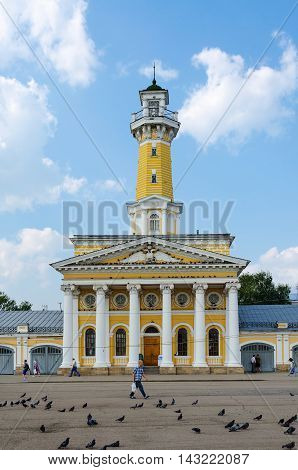 KOSTROMA RUSSIA - JULY 20 2016: Unidentified people are on Susaninskaya square near building of fire tower (outstanding architectural monument of epoch of classicism one of attractions of city) Kostroma Russia
