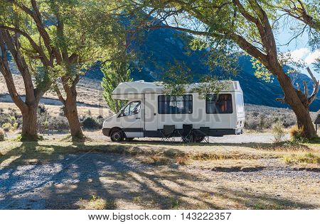 Motorhome Camper At Lake Pearson / Moana Rua Wildlife Refuge Located In Craigieburn Forest Park In C