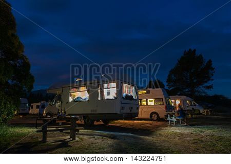 Campervans Camping At Peketa Beach, Kaikoura, South Island Of New Zealand, During Sunset