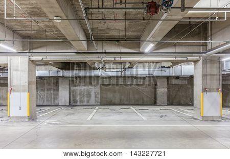 Parking garage underground interior with neon lights Empty Parking lot Car park at underground building