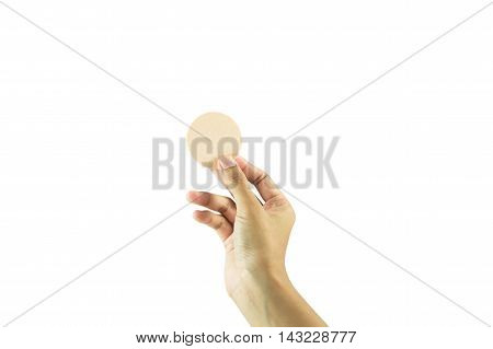Close up of hand holding cosmetic sponges isolated on a white background.