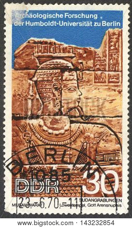 MOSCOW RUSSIA - CIRCA JUNE 2016: a post stamp printed in DDR shows Head of God Arensnuphis carvings unearthed at Lions Temple the series