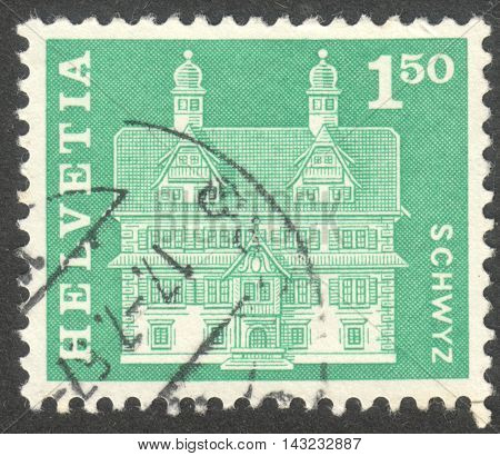 MOSCOW RUSSIA - CIRCA JUNE 2016: a post stamp printed in SWITZERLAND shows Reding house Schwyz circa 1963