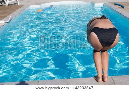 Girl Standing On Pool, Preparing To Dive