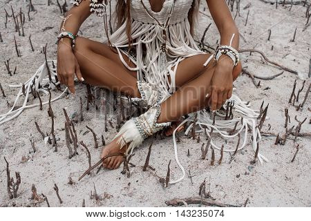 Close up of attractive wild boho woman at beach